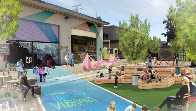 The McConnell Foundation would convert the warehouse on the former police station property downtown into a seasonal pop-up market with a public space. The market would front California Street and use the existing warehouse bays as storefronts.