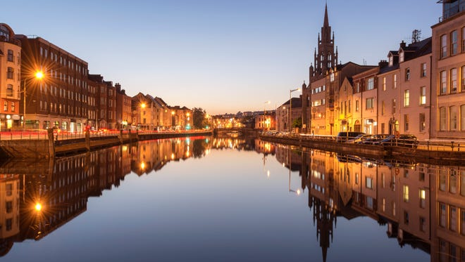 A view of the River Lee in Cork City, Ireland, at night.