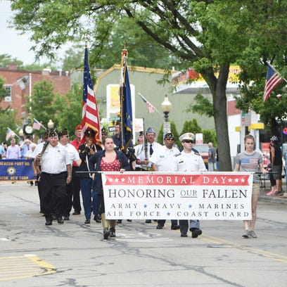 American Legion Commander John Eagen of Hyde Park places a wreath on the Dutchess County War Memorial in Poughkeepsie Monday.