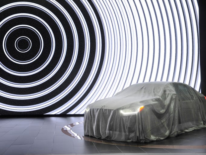 The Hyundai Genesis G90 waits to be unveiled at the