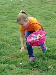 Addyson Peters hunts for eggs at the 2016 Easter Egg Hunt sponsored by the Parks & Recreation Department and the University Kiwanis Club in Lucy Park.