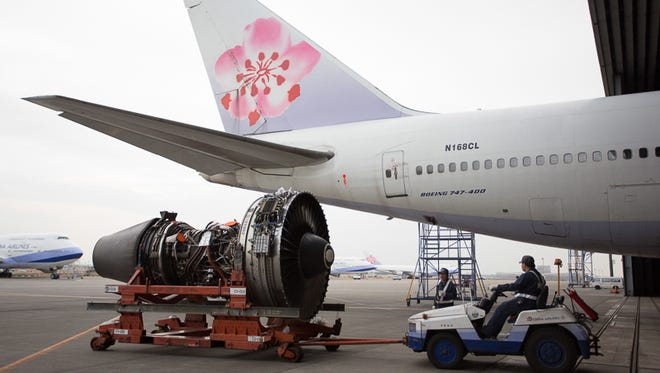 An engine is shuttled through the China Airlines maintenance facility at Taoyuan International near Taipei, Taiwan.