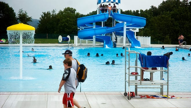 """""""NEWS Evening Sun Photo by Brett Berwager Visitors of the newly renovated Codorus State Park Swimming Pool try to beat the heat Sunday during the second day of the newly renovated pool."""""""