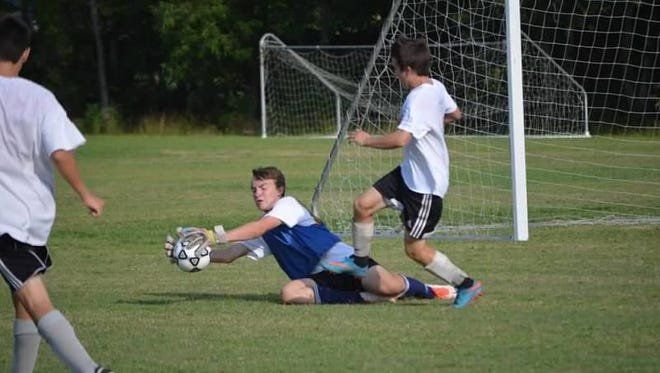 Roberson goalkeeper Evan Goosman and the Rams are home for Monday's game against Asheville High.