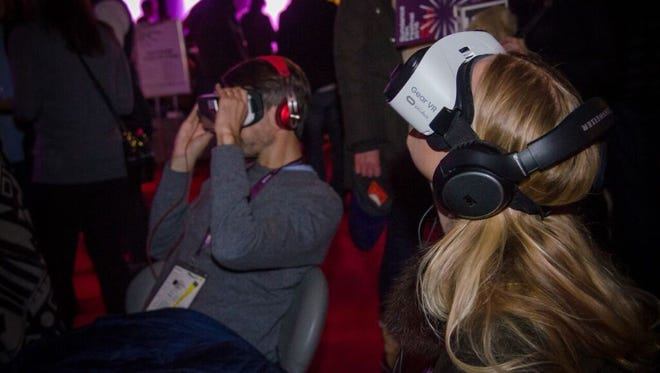 Visitors at the Sundance Film Festival check out virtual reality using Samsung's Gear VR.