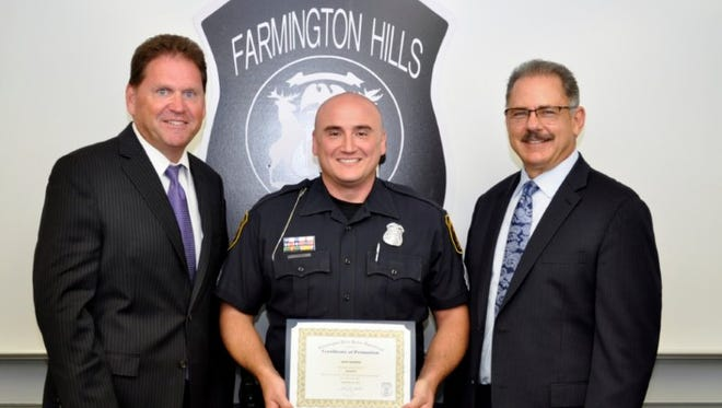 Farmington HIlls City Manager Dave Boyer, Sgt. Kurt Bearer and Police Chief Chuck Nebus.