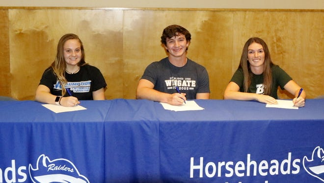 Horseheads seniors, from left, Elise Keister, Bryson Balash and Alli Richmond signed National Letters of Intent on Wednesday afternoon during a ceremony at Horseheads High School.