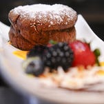 The flourless chocolate souffle with a berry medley served with mango, kiwi and raspberry sauces prepared at Roy's restaurant inside the Hilton Guam Resort & Spa in Tumon on June 30. Rick Cruz/PDN