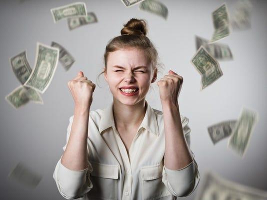 money-raining-on-woman-celebrating_large.jpg