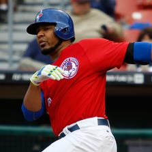 Edwin Encarnacion swings the bat for the Bisons Wednesday night.