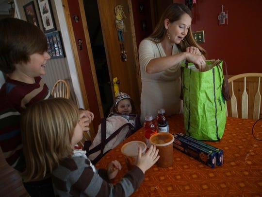 Christine Morris goes through a bag of provisions for the upcoming birth of her fifth child at the Birth Center in Wilmington. She's made eating spaghetti a tradition now after giving birth.