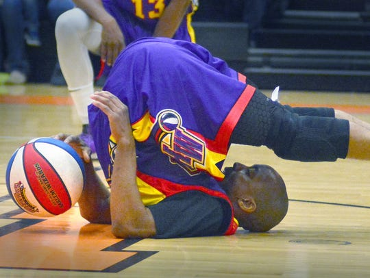 The Harlem Wizards' King Arthur shows off his dribbling