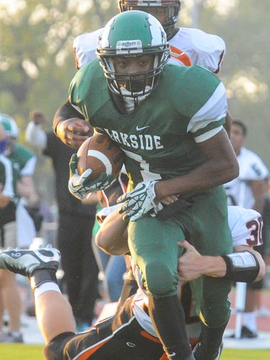 Parkside running back Dabryant Crockett rushes down the sidelines before being wrapped up against Easton on Friday night at County Stadium.