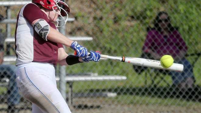 South Kitsap's Statia Cermak hits a single against Curtis in a South Puget Sound League 4A game in Port Orchard on Wednesday.