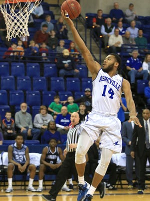 UNC Asheville's Ahmad Thomas has excelled during the Big South Conference schedule despite a nagging ankle injury.