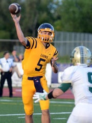 South Lyon quarterback Carlo Zoratti makes the passing