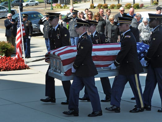 The body of Pfc. Cecil E. Harris  of Shelbyville, a World War II  soldier who was killed  in action in France in 1945 but whose remains were not discovered until last year, is carried into the Red Bank Baptist Church  on Friday Aug. 29, 2014, in Chattanooga, Tenn.
