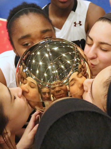 Ossining players celebrate after beating North Rockland