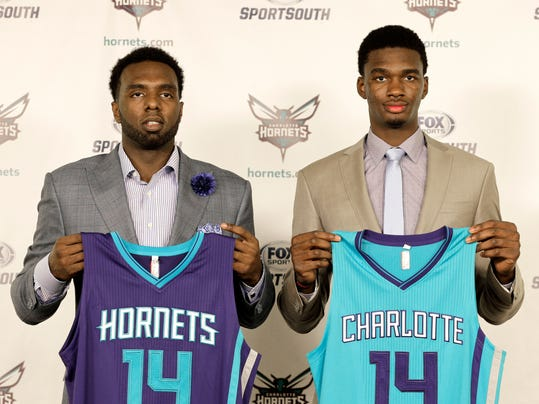 New Charlotte Hornets players P.J. Hairston, left, and Noah Vonleh, right, pose for a photo during a new conference in Charlotte, N.C., Friday, June 27, 2014. (AP Photo/Chuck Burton)