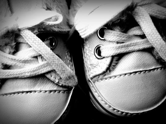 baby shoes file photo