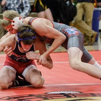 Arrowhead's Travis Case gave up football to focus on wrestling, and now he's headed to state (along with seven other Warhawks)