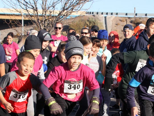 "The kid's one-mile fun run was first to here the starting gun at the 15th annual Ultimate Fitness Turkey Trot on Thanksgiving Day at Voiers' ""Pit"" Park. The races drew over 300 people on a warm Nov. 23 morning."