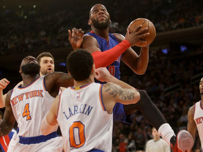 Detroit Pistons' Andre Drummond, top, drives past New