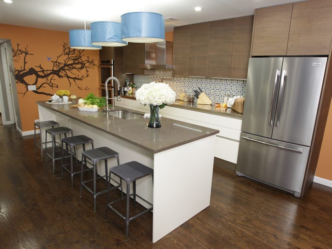 Kitchen Cousins John Colaneri and Anthony Carrino remodeled the kitchen in John's parents' home. They added a sprawling 12-foot kitchen island, Italian wood and lacquer cabinets and a Moroccan-themed backsplash.
