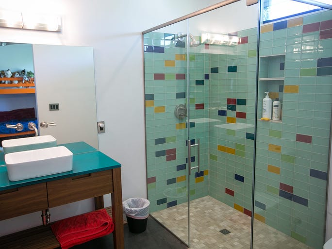 A bathroom at Lynda Person and John Peterson's modern home, designed by local architect Eric Spry, in north Phoenix on Wednesday, July 30, 2014.
