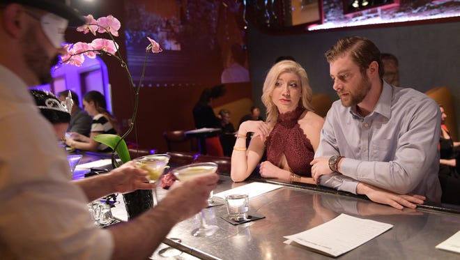 Hayley Dudek and Bryce Bisching are served at Elliott's Martini Bar on Tuesday, February 14, 2017. The bar brought the art of martinis and cocktails to Fort Collins and is celebrating its 20th anniversary.