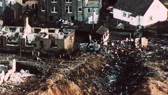 A 1988 photo shows wrecked houses and a deep gash in the ground in the village of Lockerbie, Scotland, caused by the crash of Pan Am Flight 103.