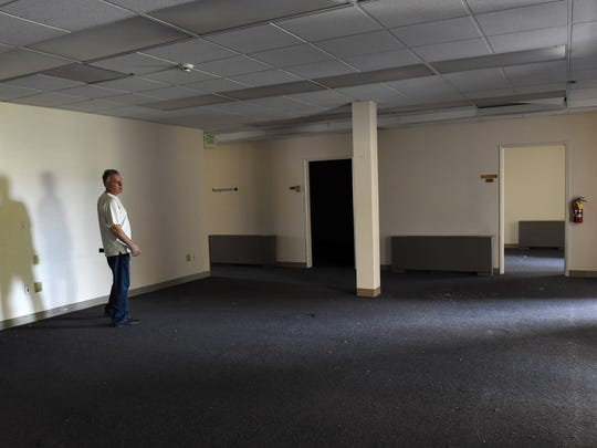 Ky Good walks throught the upstairs of the new C4CUBE building in Midtown on Oct. 14, 2014.