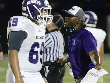 Fremont Ross coach Craig Yeast speaks with offensive lineman Charlie Clark during the Little Giants' 45-28 loss to St. John's last week.