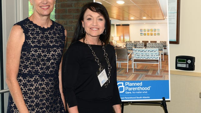 Cecile Richards, president of the Planned Parenthood Federation of America, left, along with Planned Parenthood South Atlantic CEO Jenny Black, right, stand for a picture at the new Planned Parenthood clinic located just south of downtown. The nonprofit health care provider opened a new clinic in Asheville in January and started performing abortions last month.