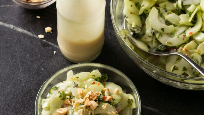 Cucumbers served up with a garlic-and-miso dressing give a snap to this cool salad.