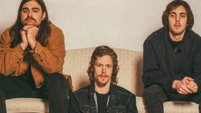 Members of Columbus-based Caamp, from left: bassist Matt Vinson, singer/guitarist Taylor Meier and banjo player Evan Westfall.