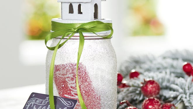 A Mason jar you decorate can be a fun way to give a gift card.