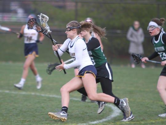 Hartland's Emily Beazley drives to the net to score