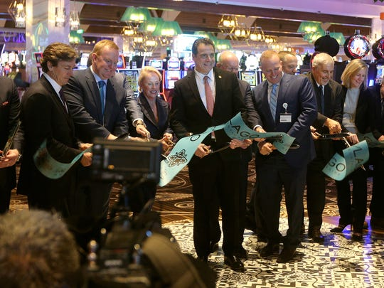 Dignitaries, including Gov. Andrew Cuomo (center), cut a ribbon at the grand opening of del Lago Resort and Casino  in Tyre, Seneca County.