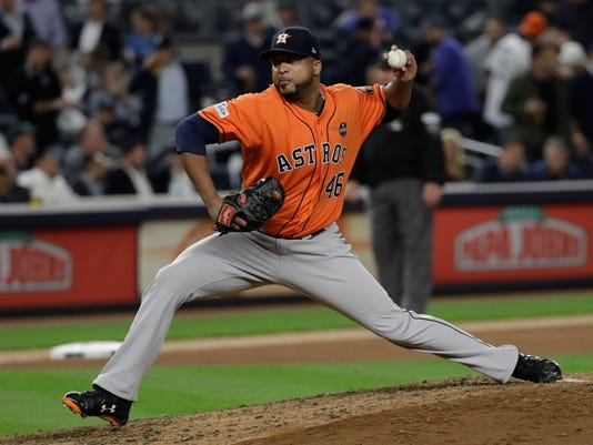 FILE - In this Oct. 18, 2017, file photo, Houston Astros relief pitcher Francisco Liriano throws during the eighth inning of Game 5 of baseball's American League Championship Series against the New York Yankees in New York. The Detroit Tigers have added depth to their pitching staff by agreeing to a $4 million, one-year contract with left-hander Liriano. The move was announced during the Tigers' spring training opener Friday, Feb. 23, 2018, against the Yankees. (AP Photo/David J. Phillip, File)