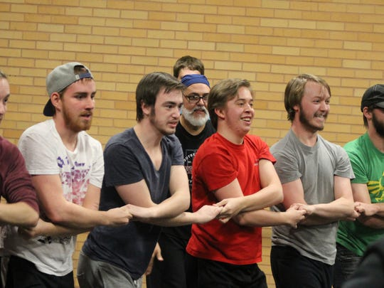 """The male ensemble for SUU's """"Fiddler on the Roof"""" rehearse for the upcoming production."""
