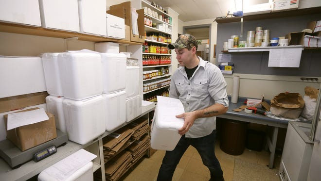 At Calabresella Deli in Gates, Stephen Nesbitt packs about 150 containers each day containing Rochester food favorites like Zweigles, Abbott's and a variety of local hot sauces, to be shipped around the country.
