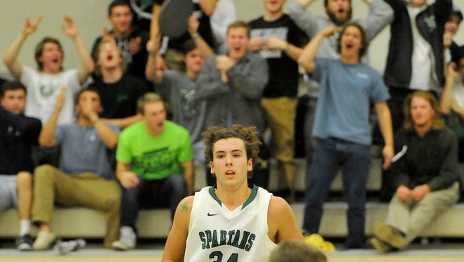 The York College fans erupt after Dalton Myers, foreground, hit a 3-pointer during the Spartans' 66-47 victory against Gettysburg College on Monday.