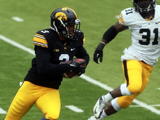Iowa wide receiver Jay Scheel runs down field during
