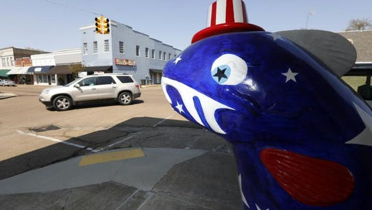 "An oversized patriotic themed ""catfish"" stands at one"