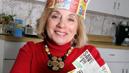 "Susan Samtur, who is known nationally as the ""Coupon Queen,"" is photographed with her accordion file that she uses to organize her coupons and newspaper circulars that she clips from every week, Feb. 5, 2011 in her Scarsdale home."
