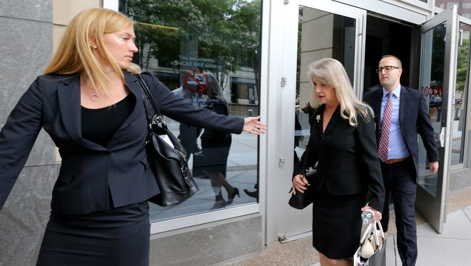 Maureen McDonnell, center, and two of her lawyers, Heather Martin, left, and Stephen Michael Hauss, right, leave the federal courthouse July 29, 2014, in Richmond, Va.