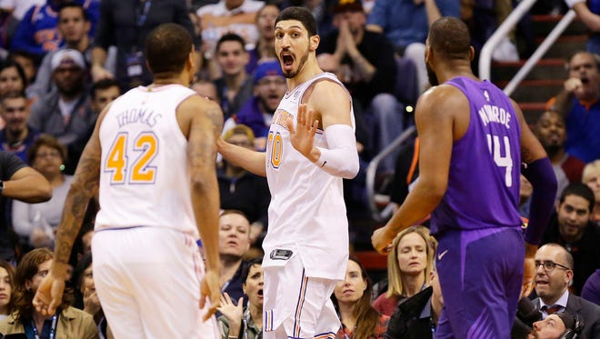 New York Knicks Enes Kanter reacts after being pushed by Phoenix Suns Devin Booker and Greg Monroe in the 2nd half at Taking Stick Resort Arena on Jan. 26, 2018 in Phoenix, Ariz. Booker was ejected form the game.
