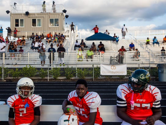 Broward players sit on the bench during the FBU National