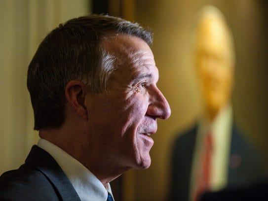 Gov. Phil Scott answers questions at the Statehouse